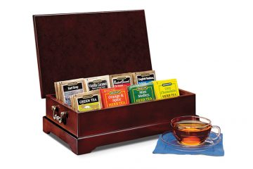 "Impress guests with your knowledge and appreciation of fine tea. Beautifully crafted with an elegant cherry finish and brass hardware, our chest contains 64 individually foil wrapped tea bags: 8 tea bags each of: Earl Grey, Vanilla Caramel, ""Constant Comment""®, English Teatime, Green Tea, Orange & Spice Herb, Mint Medley Herb, and Cozy Chamomile Herb teas. Chest can be refilled with your favorite blends.